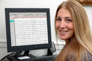 girl in front of EEG facing camera